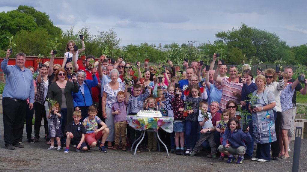 Members celebrate the first birthday with a BBQ last summer