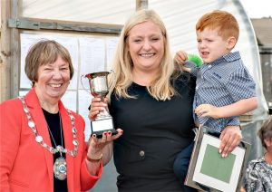 "Elaine Lewis (holding son Connor) receiving the ""Braehead Cup"" from Provost Christine Simpson"