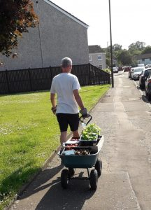 Trust Chairman Matthew Power takes a delivery of fresh produce to North Parish Church hall to be made available through the Heart of Braehead food project